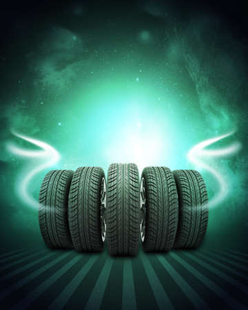 vulcanization: Wedge of new car wheels. Abstract green background is night sky and stripes at bottom Stock Photo