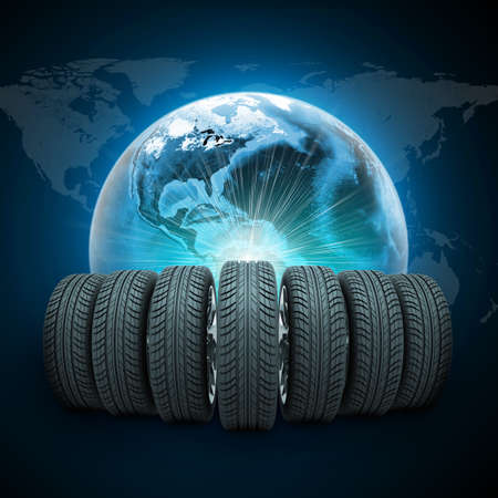 vulcanization: Wedge of new car wheels. Earth with light and world map on dark blue background. Elements of this image furnished by NASA