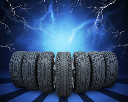 vulcanization: Wedge of new car wheels. Abstract blue background with lightning and stripes at bottom