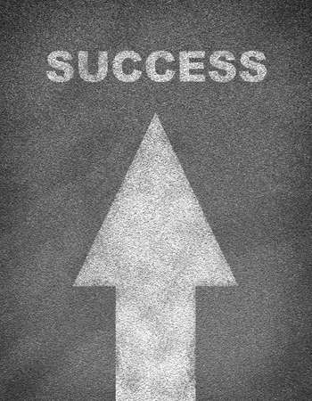 marking up: Asphalt road texture with arrow and word success. Business concept