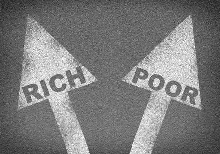 marking up: Asphalt road texture with two arrows. Words rich and poor. Business concept Stock Photo