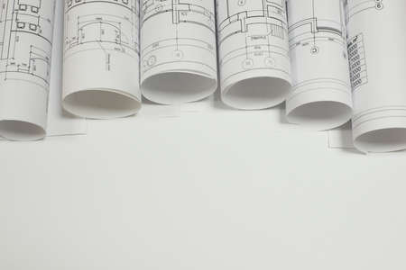 drawings image: Scrolls architectural drawings on white background. Cropped image