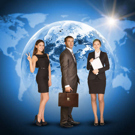 Three business person. Earth with world map and sun as backdrop. Elements of this image furnished by NASA photo