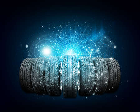 vulcanization: Car wheels. Abstract dark background is magic lines and stripes at center