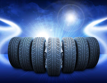 vulcanization: Wedge of new car wheels. Abstract blue background is lines and lights