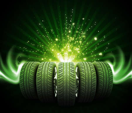 vulcanization: Wedge of new car wheels. Abstract green background is magic lines and stripes at center