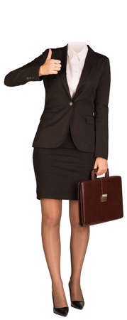 Businesswoman in suit without head, holding briefcase and showing thumb-up. Isolated on white background
