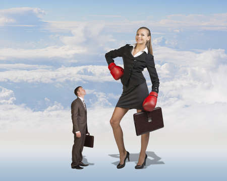 short gloves: Conceptual Small Serious Businessman Staring at Giant Smiling Businesswoman with Boxing Gloves and Briefcase on White Clouds Background