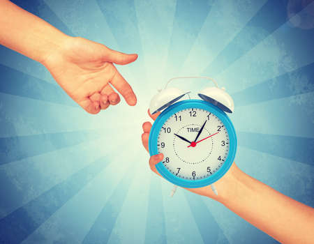 abstract alarm clock: Alarm clock with pointers. Abstract light blue background