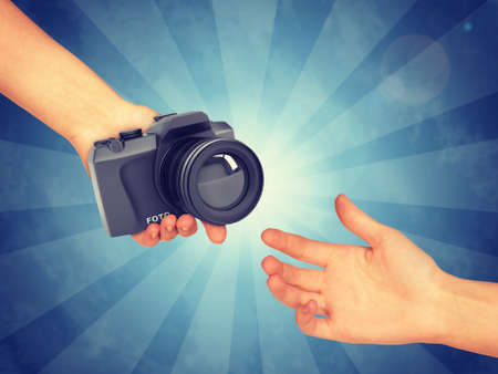 lucid: Hand passing DSLR camera. Abstract blue background