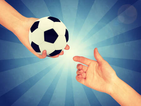 lucid: Soccer ball in hand. Abstract blue backround. Light with stripes