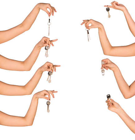 both sides: Womans hands holding house keys on white isolated background from both sides of picture
