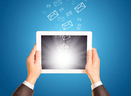 sending: Business man using tablet. Sending and getting emails