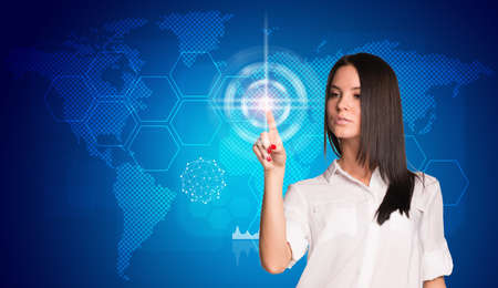 Touching button social network future interface. Businesswoman pressing light point on holographic screen. Social network concept photo