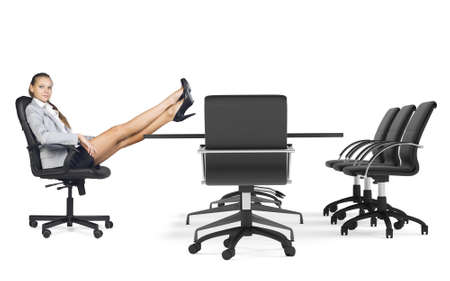 businesslady: Businesslady sitting in chair with her crossed legs on table. Office on isolated background