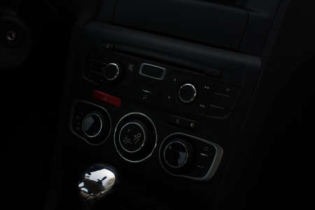 ignition: Car panel with ignition and buttons. Speed control lever. Interior Stock Photo