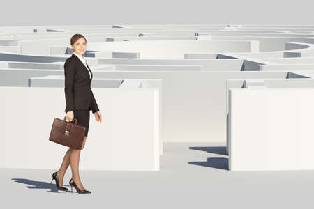 Businesswoman with suitcase looking at camera, entering labyrinth, closed view. Isolated background, virtual model photo