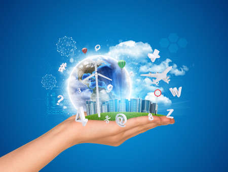 Cityscape earth model in hand on blue background. Elements of this image furnished by NASA photo