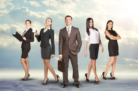 Young attractive business people with man in center looking at camera on abstract background photo