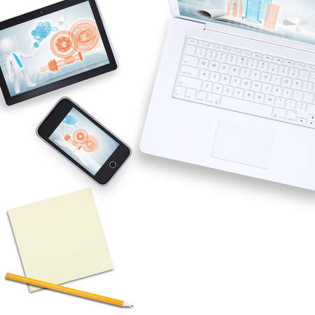 Laptop with tablet and mobile phone with note paper on isolated white background, top view photo