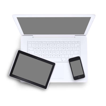 top  model: Tablet and mobile phone on laptop in isolated white background, top view Stock Photo