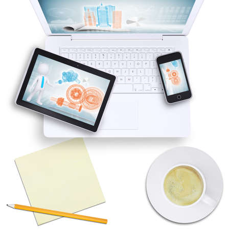 Tablet and mobile phone on laptop with coffee cup on isolated white background, top view photo