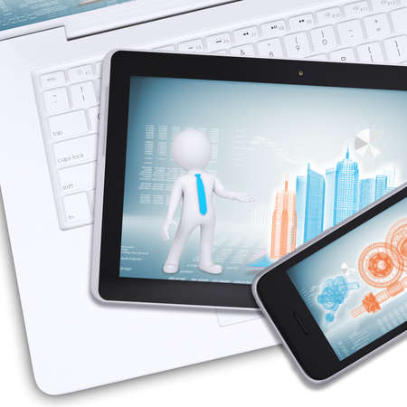 Tablet and mobile on laptop with engineering drawings on isolated white background, top view photo