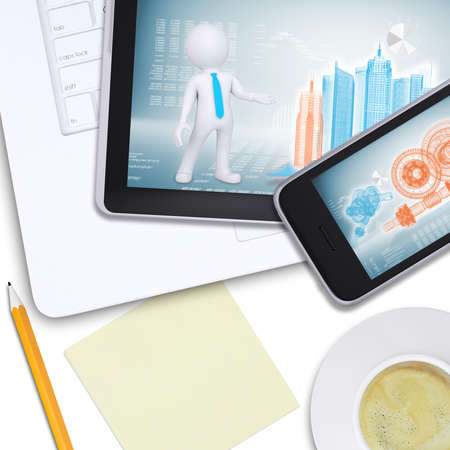 Tablet and mobile on laptop with engineering drawings, note paper on isolated white background, top view photo