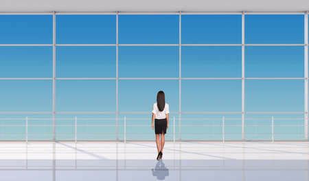 businesslady: Young businesslady standing back in front of window. Interior view