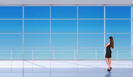 businesslady: Young businesslady half-turned in black dress with crossed arms and standing back in front of window. Interior view Stock Photo