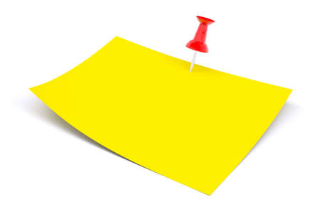 fasten: Yellow sticker fasten with red pin on isolated white background
