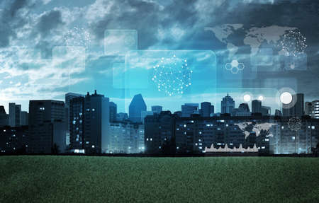 holographic: Cityscape with holographic screen and graphical charts Stock Photo