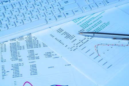 graphical: White keyboard with graphical charts and documents Stock Photo