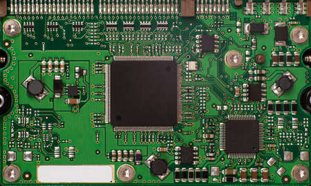 main board: Green baseboard with packaged chip, close up view Stock Photo