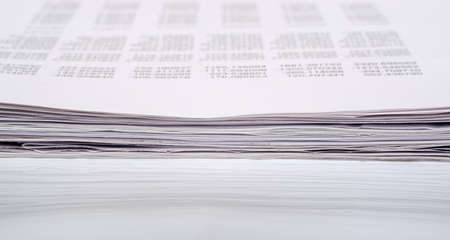 financial item: Ream of paper with numbers on isolated white background Stock Photo