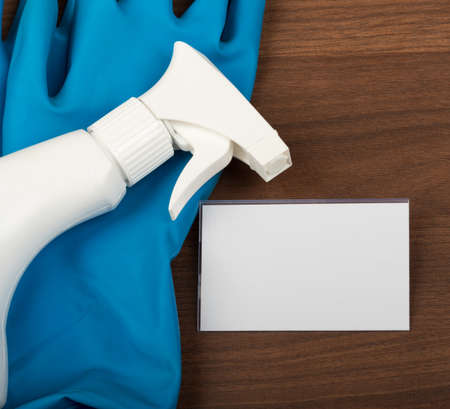 rubber gloves: Airbrush with rubber gloves and badge on  brown wooden table