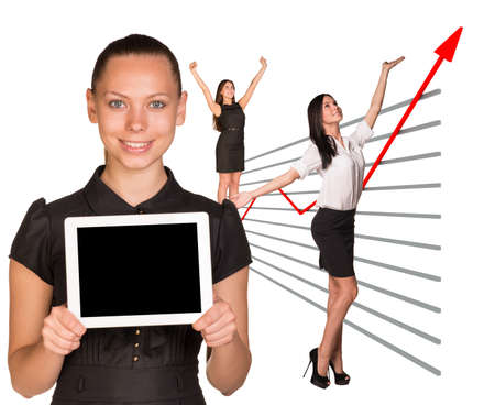 Happy business women and graphical chart on isolated white background photo