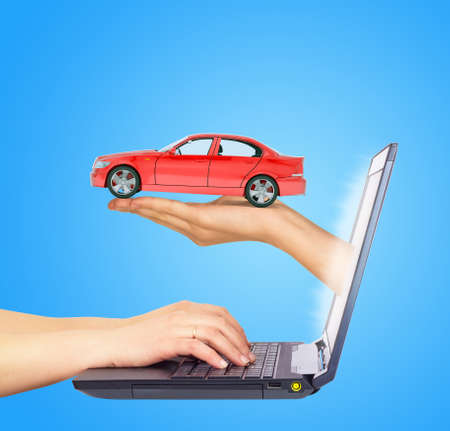 tailpipe: Humans hands working on laptop on blue background