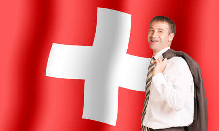 cross ties: Smiling businessman with jacket on shoulder looking at camera on Switzerland flag background