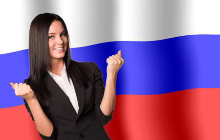russia flag: Smiling woman in winner posture on Russia flag background