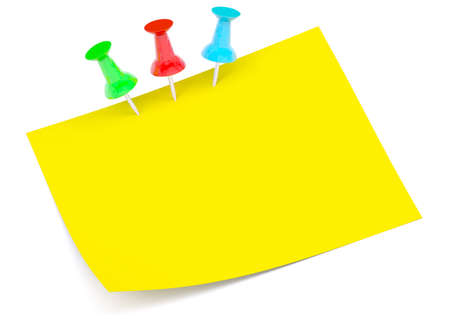 drawing pins: Yellow sticker with three colorful drawing pins on isolated white background