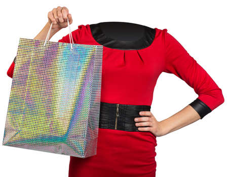 body bag: Woman body without head handing colorful shopping bag on isolated background