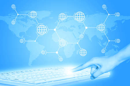 womans: Womans hand pressing on keyboard on abstract blue background with world map