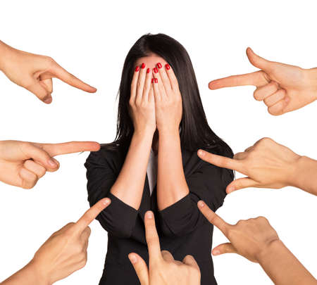 businesslady: Businesslady hiding her face and set of hands pointing at her on isolated white background