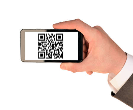 qrcode: Businessmans hand holding smartphone with QR-code on isolated white background Stock Photo