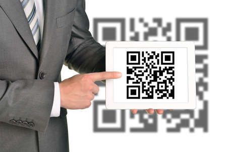 qrcode: Businessman holding picture with QR-code on isolated white background with code