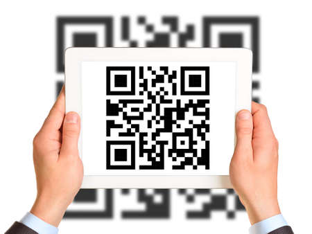 qrcode: Businessmans hands holding picture with QR-code on isolated white background with code