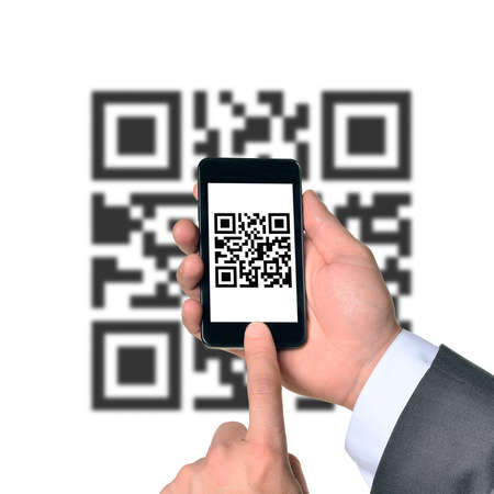 qrcode: Businessman using smartphone with QR-code on isolated white background with code