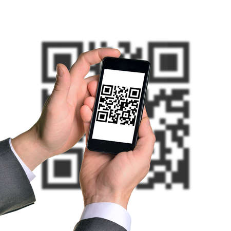qrcode: Businessmans hands holding smartphone with QR-code on isolated white background with code
