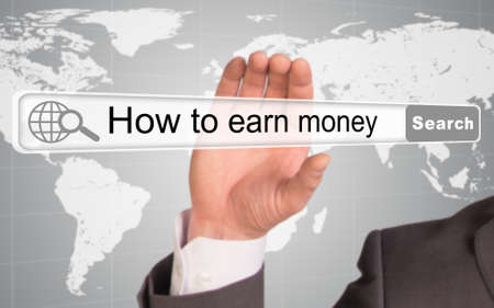 earn money: Businessmans hand holding browser with words how to earn money on abstract background Stock Photo